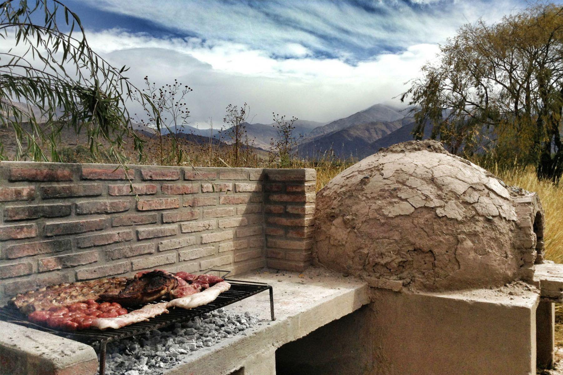 Asador y horno de barro